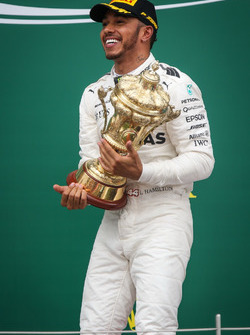 Race winner Lewis Hamilton, Mercedes AMG F1 celebrates on the podium
