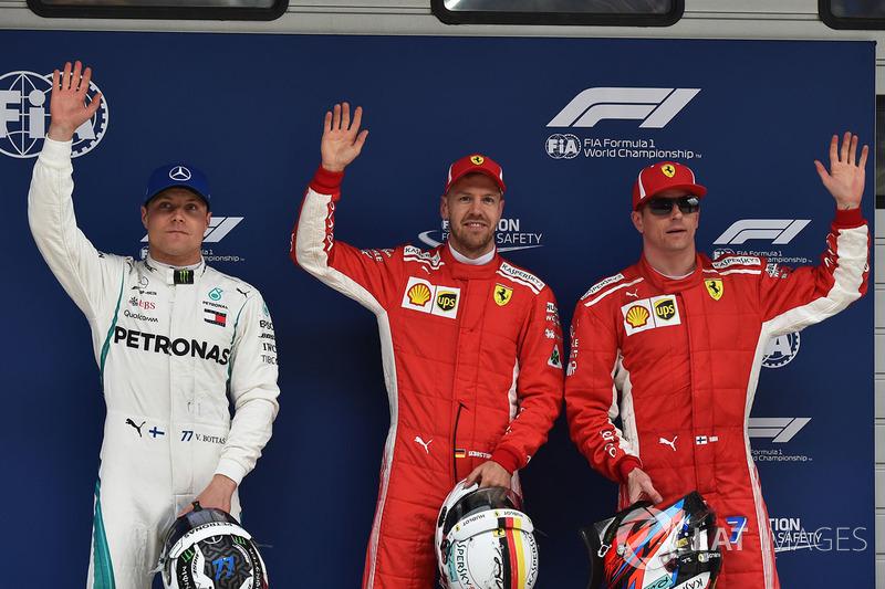 Le poleman Sebastian Vettel, Ferrari, le deuxième, Kimi Raikkonen, Ferrari, le troisième, Valtteri Bottas, Mercedes AMG F1