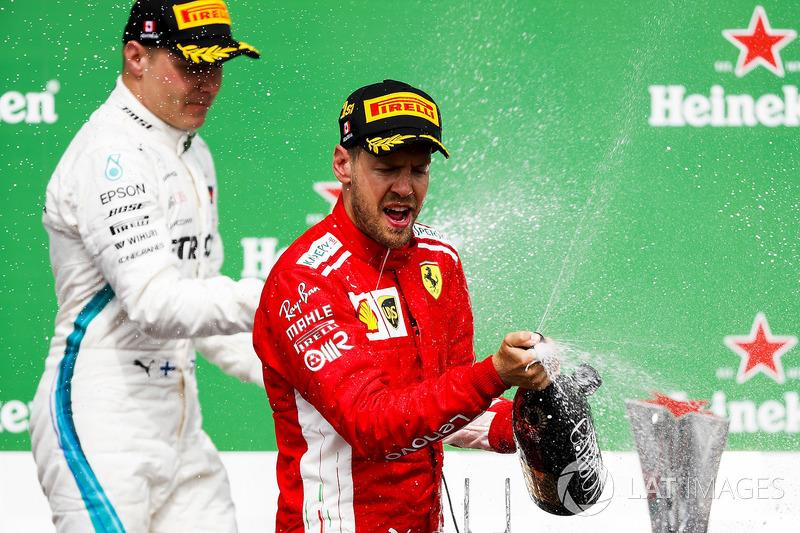 Valtteri Bottas, Mercedes AMG F1, 2nd position, and Sebastian Vettel, Ferrari, 1st position, spray C