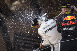 Race winner Lewis Hamilton, Mercedes-AMG F1 and Max Verstappen, Red Bull Racing celebrate on the podium with the champagne