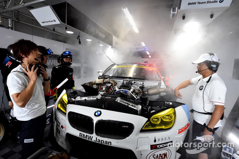 #7 BMW Team Studie BMW M6 GT3: Jorg Muller, Seiji Ara, Augusto Farfus in the garage with smoke