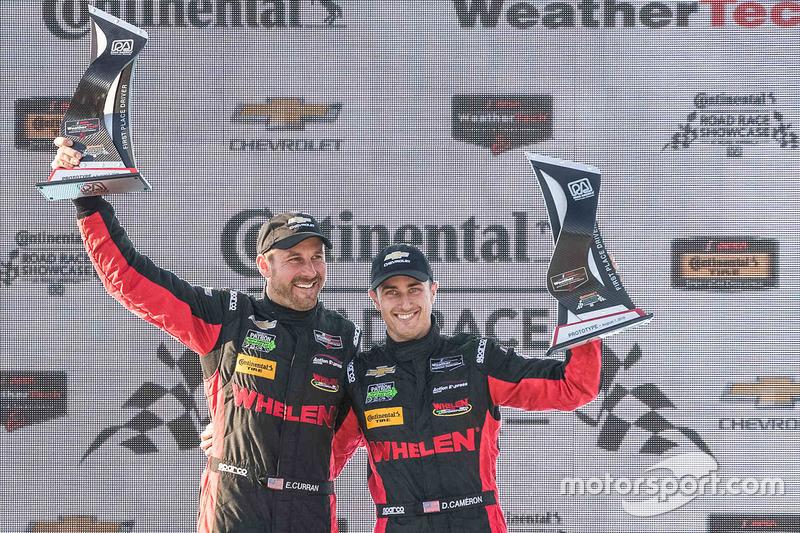 Overall podium: winners Eric Curran, Dane Cameron, Action Express Racing