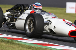 Takuma Sato drives a Honda RA300