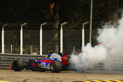 Carlos Sainz Jr., Scuderia Toro Rosso STR12, stops his car as his engine smokes