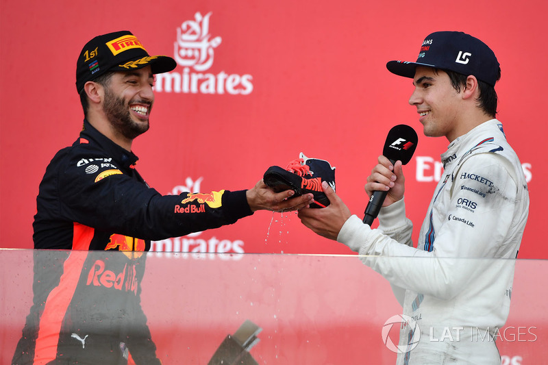 Daniel Ricciardo, Red Bull Racing and Lance Stroll, Williams shoey on the podium