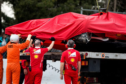 The crashed Ferrari SF70H of Kimi Raikkonen, Ferrari is recovered back to the pits on the back of a truck