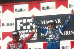 Podium: second place Ayrton Senna, McLaren Honda congratulates race winner Thierry Boutsen, Williams Renault