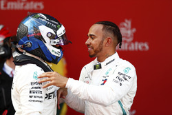 Lewis Hamilton, Mercedes AMG F1, celebrates victory in parc ferme with Valtteri Bottas, Mercedes AMG F1