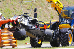 The damaged Romain Grosjean Haas F1 Team VF-18 is removed from the circuit by marshals