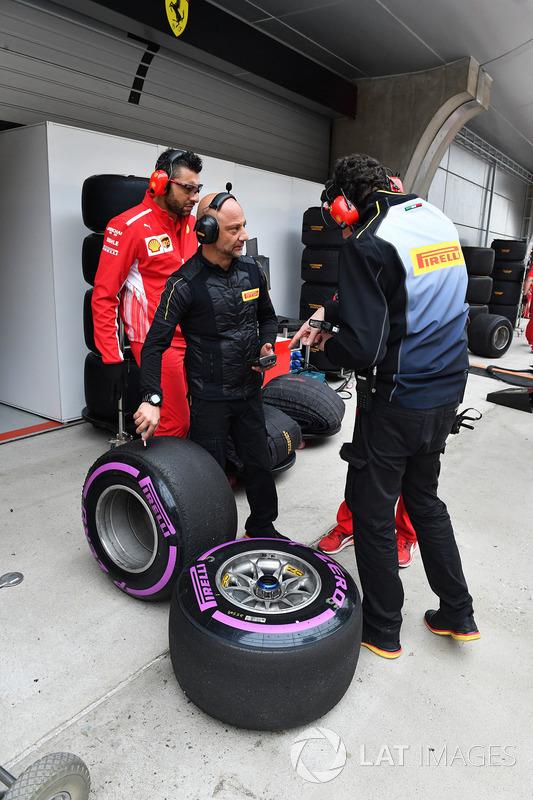 Ferrari and Pirelli engineers with Pirelli tyres