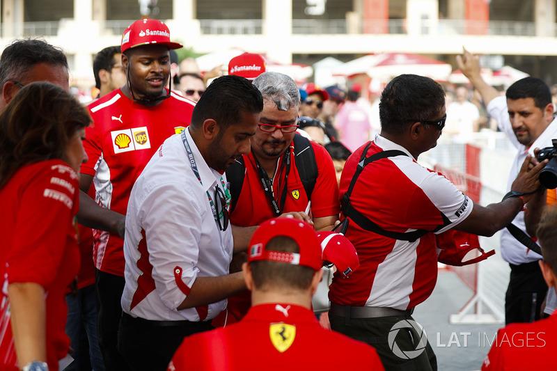 Fans queue up for autographs of the Ferrari drivers