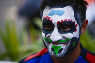 A Toro Rosso mechanic sports a painted face
