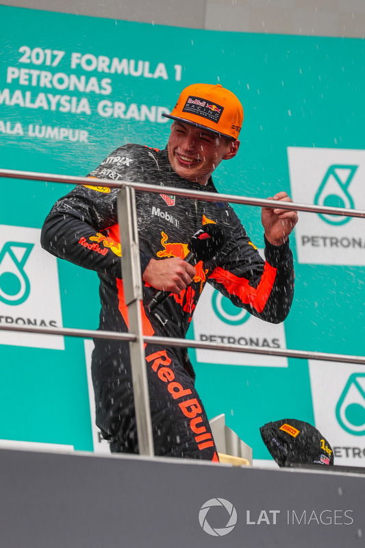 Race winner Max Verstappen, Red Bull Racing celebrates on the podium, the champagne