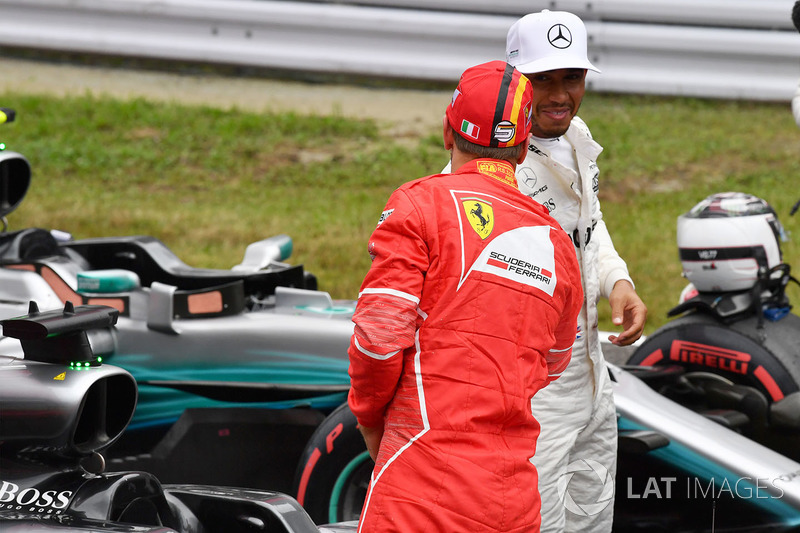 Sebastian Vettel, Ferrari y Lewis Hamilton, Mercedes AMG