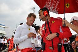 Sebastian Vettel, Ferrari on the grid with Riccardo Adami, Ferrari Race Engineer