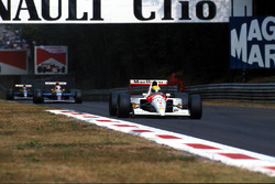 Ayrton Senna, McLaren MP4/6; Nigel Mansell, Williams FW14; Riccardo Patrese, Williams FW14