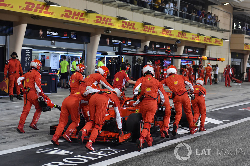 The car of Kimi Raikkonen, Ferrari SF71H is pushed back in pit lane