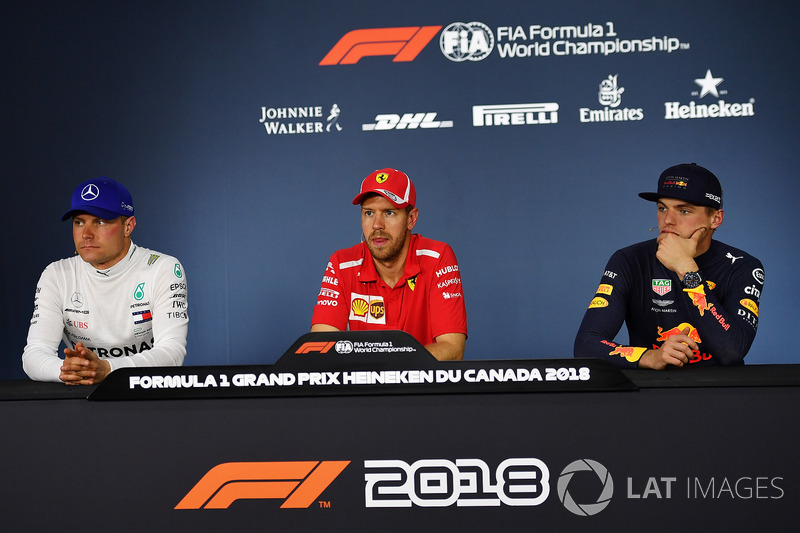 (L to R): Valtteri Bottas, Mercedes-AMG F1, Sebastian Vettel, Ferrari and Max Verstappen, Red Bull Racing in the Press Conference