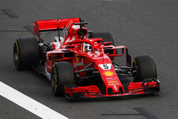 Sebastian Vettel, Ferrari SF71H, punches the air at the finish, after taking victory