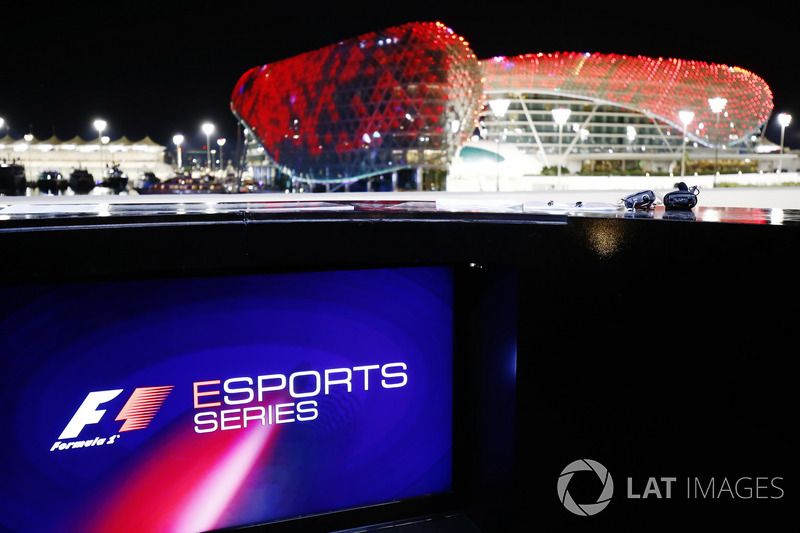 F1 Esport logo on a screen, the circuit buildings in the background