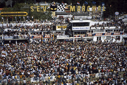 Jacky Ickx, Derek Bell, Porsche 956 after the finish