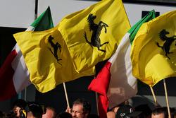 Ferrari celebrate at the podium with flags