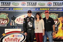 Race winner Erik Jones, Joe Gibbs Racing Toyota, with parents