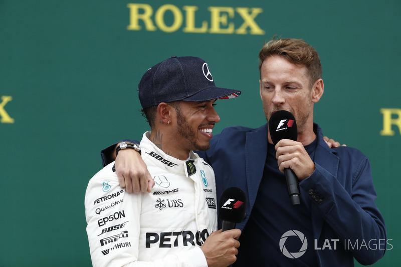 Race winner Lewis Hamilton, Mercedes AMG F1, is interviewed by Jenson Button, McLaren, on the podium