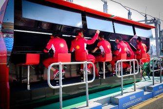 Ferrari team member on the pit gantry