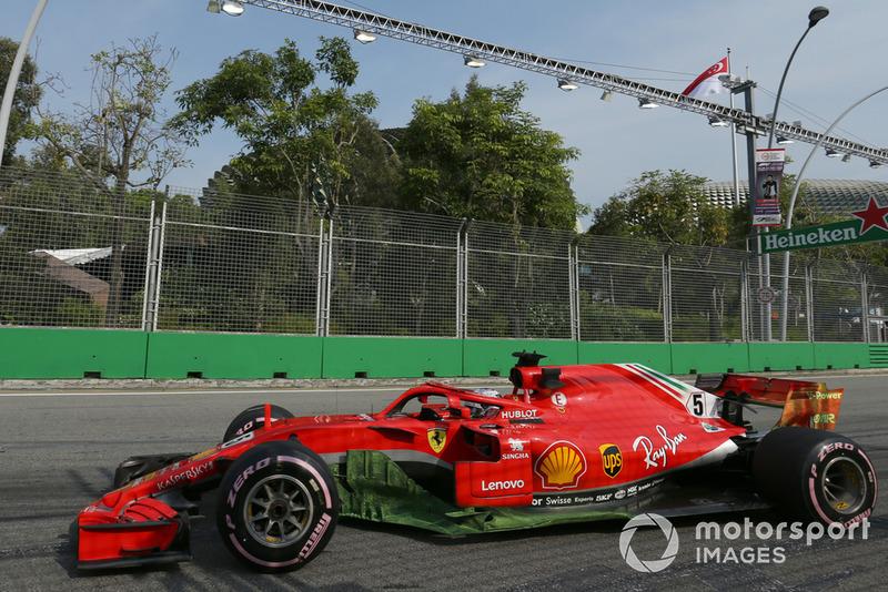 Pintura sobre el monoplaza de Sebastian Vettel