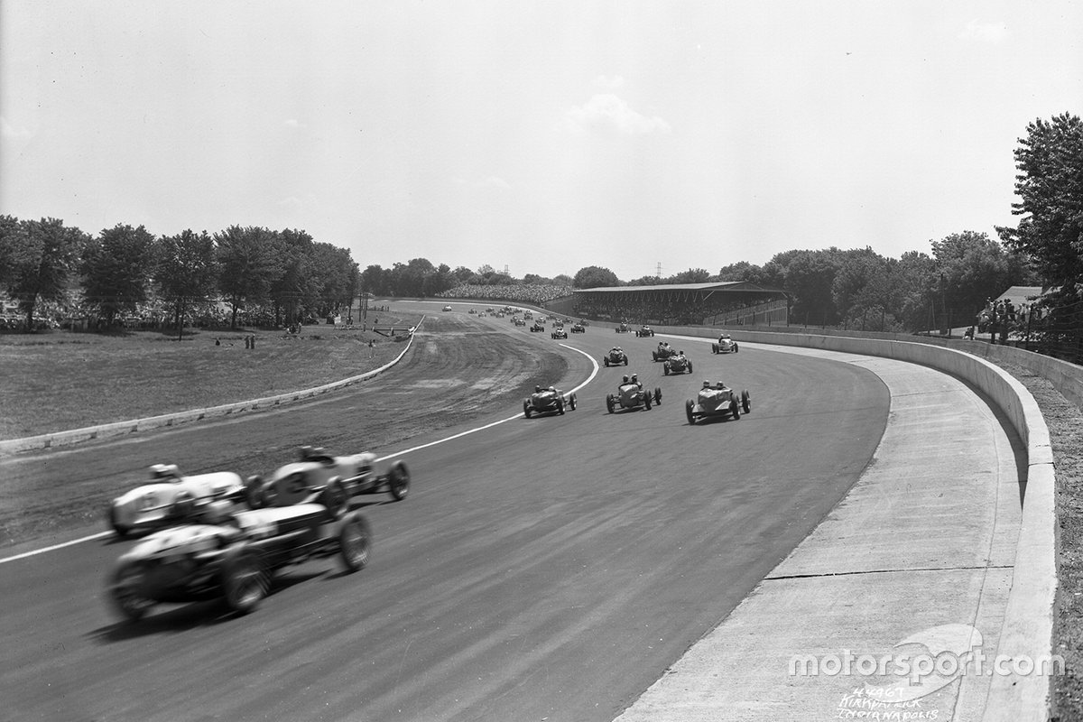 You can almost 'see' the noise in this great pic taken on the pace lap in 1937. Horn's supercharged Miller (car #3 in the middle of the last row) had been unreliable in practice, and so he took it easy in qualifying, but come the race, he finished third. Note the double wall, and the outer rim of the track now at the same angle as the main surface.