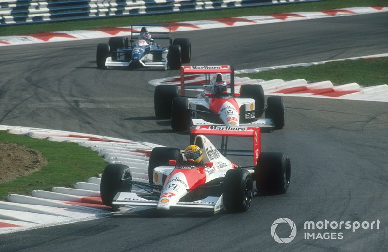 Ayrton Senna, McLaren MP4/5B Honda leads Gerhard Berger, McLaren MP4/5B Honda and Jean Alesi. Tyrrell 019 Ford