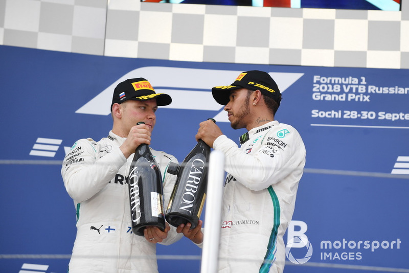 Valtteri Bottas, Mercedes AMG F1 and Lewis Hamilton, Mercedes AMG F1 with the champagne on the podium