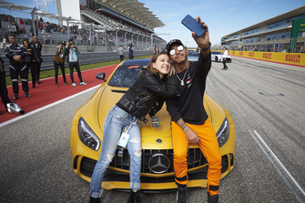 Lewis Hamilton, Mercedes AMG F1, takes a photo with actress Millie Bobby Brown