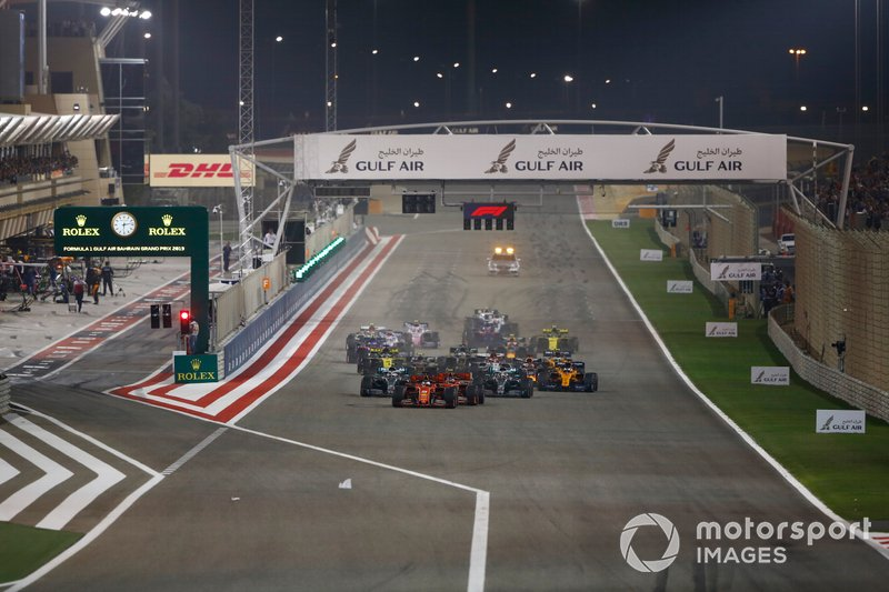 Sebastian Vettel, Ferrari SF90, leads Charles Leclerc, Ferrari SF90, Lewis Hamilton, Mercedes AMG F1 W10, Valtteri Bottas, Mercedes AMG W10, Max Verstappen, Red Bull Racing RB15, Kevin Magnussen, Haas F1 Team VF-19, and the rest of the field at the start