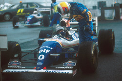 Winner Damon Hill, Williams, is congratulated by second place Michael Schumacher, Benetton