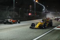 Jolyon Palmer, Renault Sport F1 Team RS17, passes the stricken car of Sebastian Vettel, Ferrari SF70H
