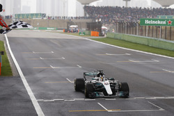 Lewis Hamilton, Mercedes AMG F1 W08, takes the chequered flag at the finish