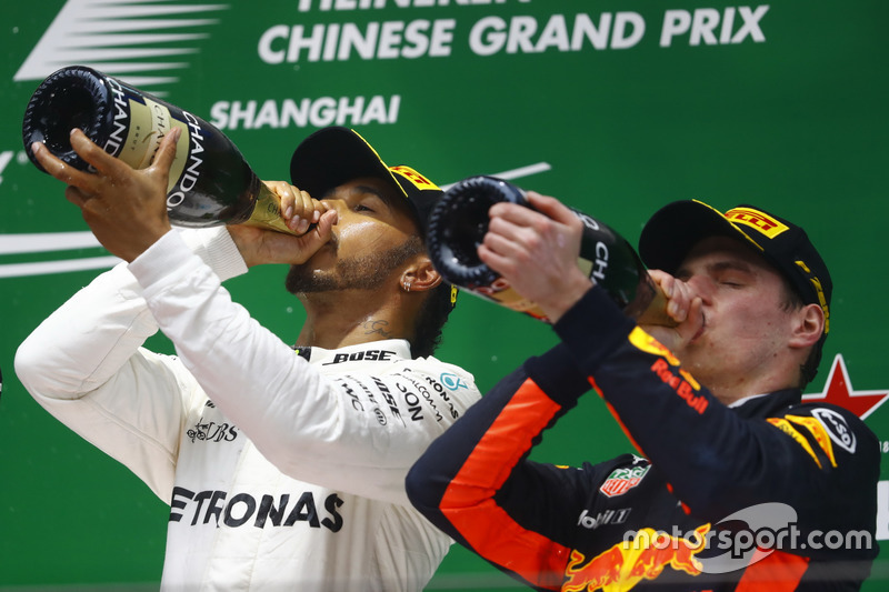 Race winner Lewis Hamilton, Mercedes AMG, and Max Verstappen, Red Bull Racing, celebrate with Champa