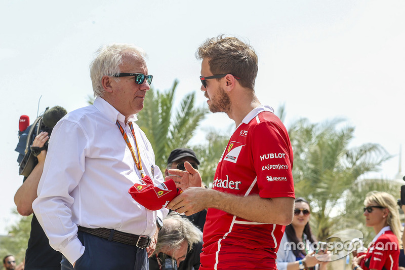 Charlie Whiting, Race Director, FIA, talks with Sebastian Vettel, Ferrari