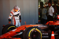Fernando Alonso, McLaren, inspects his tyres in Parc Ferme