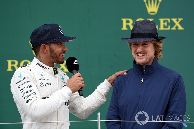 Race winner Lewis Hamilton, Mercedes AMG F1 celebrates and Owen Wilson, Actor on the podium