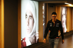 Esteban Ocon, Force India, walks past a portrait of Ayrton Senna