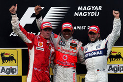 Podium: second place Kimi Raikkonen, Ferrari, Race winner Lewis Hamilton, Mclaren and third place Ni