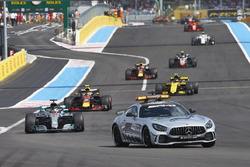 The Safety Car leads Lewis Hamilton, Mercedes AMG F1 W09, Max Verstappen, Red Bull Racing RB14, Carlos Sainz Jr., Renault Sport F1 Team R.S. 18, and Daniel Ricciardo, Red Bull Racing RB14