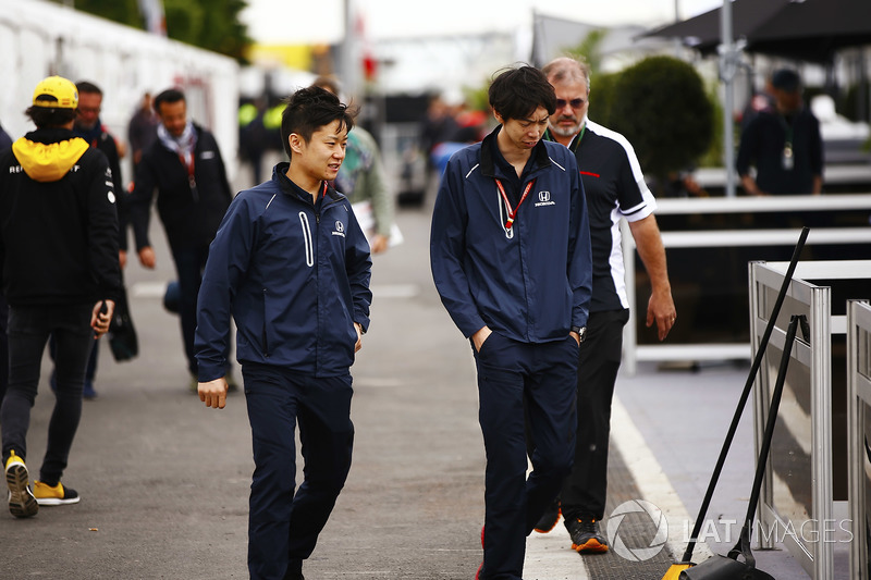 Honda personnel arrive in the paddock