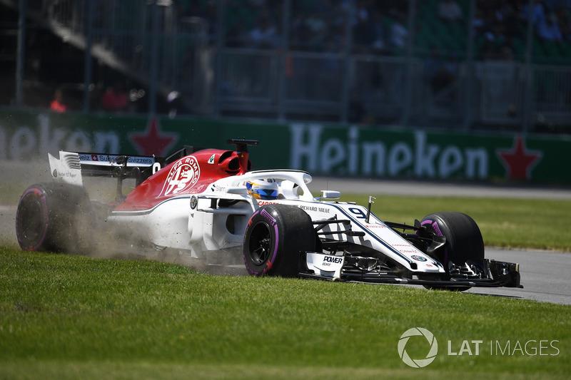 Marcus Ericsson, Sauber C37 rins wide across the grass