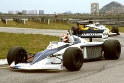 Nelson Piquet, Brabham BT52; Alain Prost, Renault RE30C