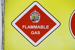 A flammable gas sign in the Haas F1 Team garage