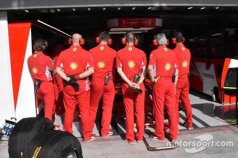Ferrari mechanics cover the garage